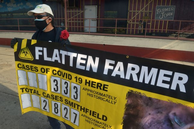 Activists call attention to slaughterhouse workers who have contracted COVID-19 while on the job in Vernon, Calif., during a rally on December 11, 2020. File Photo by Jim Ruymen/UPI