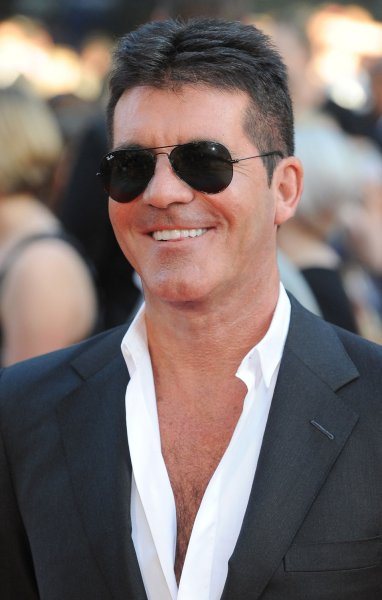 British music mogul Simon Cowell attends The World premiere of One Direction - This Is Us at The Empire Leicester Square in London on August 20, 2013. UPI/Paul Treadway
