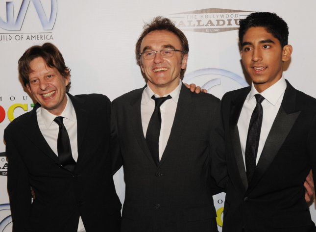 Danny Boyle (C), the director of the Oscar-nominated film Slumdog Millionaire and cast member Dev Patel (R) and producer Christian Colson (L), arrive for the 20th annual Producers Guild Awards at the Hollywood Palladium in Los Angeles on January 24, 2009. (UPI Photo/Jim Ruymen)