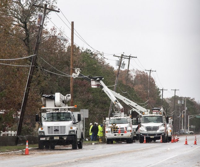 Electric workers begin restoring power to the Jersehy Shore area October 30, 2012 after Hurricane Sandy made landfall late October 29, 2012. The Category One storm knocked out power to some 8 million on the heavily populated East Coast. UPI/John Anderson