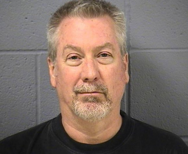 Pictured in this photo provided by the Will County Sheriff's Department is former Bollingbrook, Ill., police sergeant Drew Peterson who was arrested on May 7, 2009 and charged with the 2004 murder of his third wife Kathleen Savio. Peterson is also a suspect in the 2007 disappearance of his fourth wife, Stacy Peterson. -- (UPI Photo/Will County Sheriff's Department/HO)