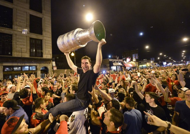 Chicago Blackhawks fans celebrate after their team defeated the Boston Bruins to win the Stanley Cup on June 24, 2013 in Chicago. The Blackhawks defeated the Bruins 3-2 in Game 6 of the Stanley Cup Finals in Boston to win the Cup 4 games to 2 in the best of seven series. (File/UPI/Brian Kersey)