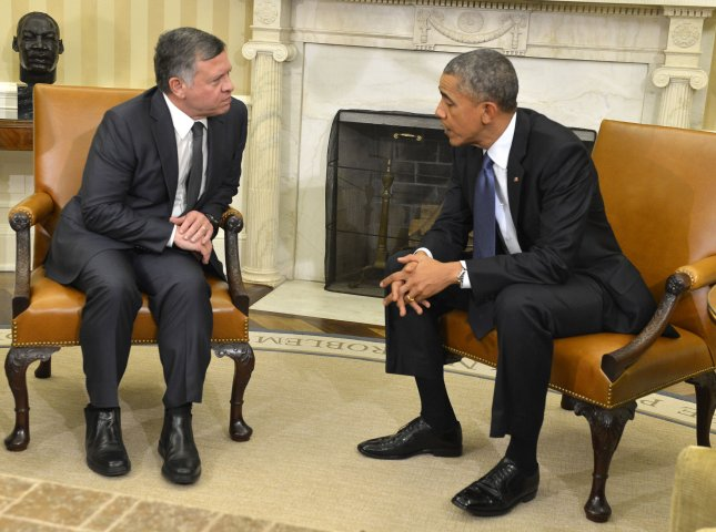 U.S. President Barack Obama (R) chats with Jordanian King Abdullah II in the Oval Office, at the White House, February 3, 2015, in Washington, DC. Earlier ISIS had released a video claiming a captured Jordanian pilot was executed by being set on fire. Photo by Mike Theiler/UPI