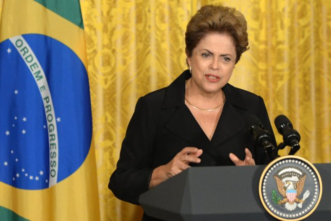 Standard & Poor's on Wednesday downgraded Brazil's investment-grade credit rating to junk status. Pictured: Brazilian President Dilma Rousseff responds to a question during joint press conference with U.S. President Barack Obama (not shown) in the East Room of the White House in Washington, D.C. on June 30, 2015. File photo by Pat Benic/UPI