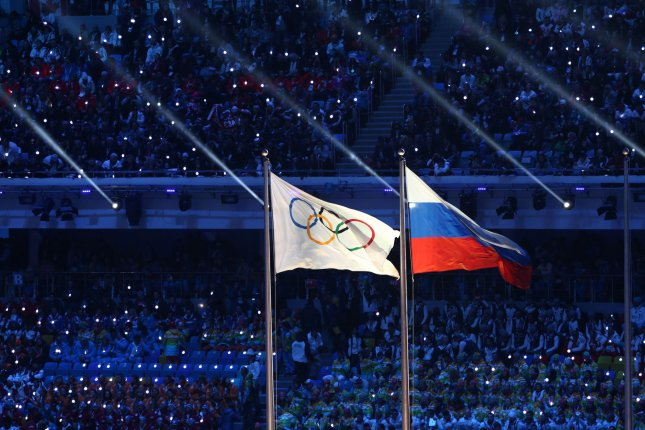 The Russian and Olympic flags fly during the Closing Ceremony at the Sochi 2014 Winter Olympics in Sochi, Russia. The World Anti-Doping Agency issued a sccathing report on November 9, 2015, accusing Russia of a pervasive doping culture of athletes. UPI/Maya Vidon-White