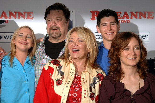 Lecy Goranson, John Goodman, Roseanne Barr, Michael Fishman and Sara Gilbert (left to right), cast members in the television comedy series Roseanne, share a moment on the red carpet at the DVD launch party for Roseanne Season 1 in Los Angeles July 18, 2005. The classic sitcom Roseanne is coming back for eight more episodes on ABC. File Photo by Jim Ruymen/UPI