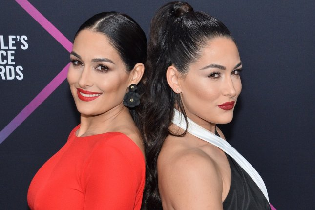 Nikki Bella (L) and her twin sister Brie Bella. The duo's E! reality series Total Bellas will be returning in early 2020. File Photo by Jim Ruymen/UPI
