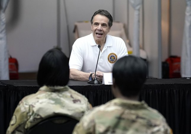 Gov. Andrew Cuomo speaks with the New York National Guard on site at the Jacob K. Javits Convention Center in New York City on Friday. Photo by John Angelillo/UPI