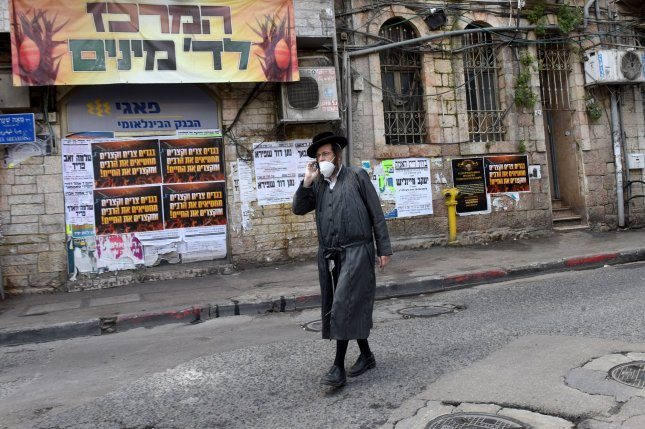 A pedestrian wears a protective mask to guard against the coronavirus outbreak in the Mea Shearim neighborhood in Jerusalem, on Thursday. Photo by Debbie Hill/UPI