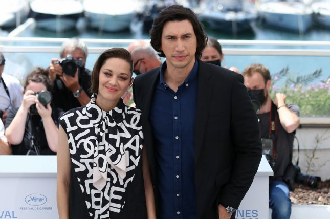 Adam Driver (R) and Marion Cotillard attend a Cannes Film Festival photocall for Annette on Tuesday. Photo by David Silpa/UPI