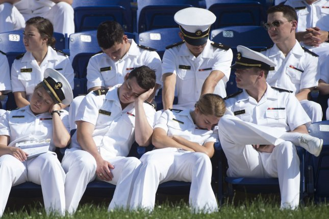 Underclass Midshipmen sleep on each other as they wait for the start of the 2016 Graduation and Commissioning Ceremony at the U.S. Naval Academy in Annapolis, Md., on May 27, 2016. File Photo by Kevin Dietsch/UPI
