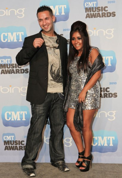 Mike 'The Situation' Sorrentino (L) and Nicole 'Snooki' Polizzi speak to the press at the Country Music Television Awards in Nashville, Tennessee on June 9, 2010. UPI/Terry Wyatt