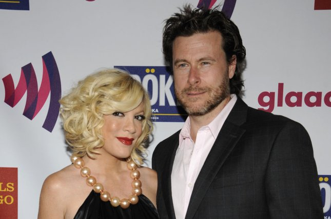 Dean McDermott (R) and wife Tori Spelling are working on a new reality show. File photo by Phil McCarten/UPI