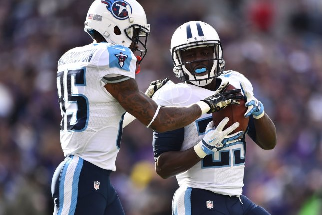 Former Tennessee Titans Leon Washington (right) celebrates with teammate Tennessee Titans wide receiver Nate Washington after Washington ran for a 3-yard touchdown in the first quarter at M&T Bank Stadium in Baltimore, Maryland on November 9, 2014. UPI/Kevin Dietsch