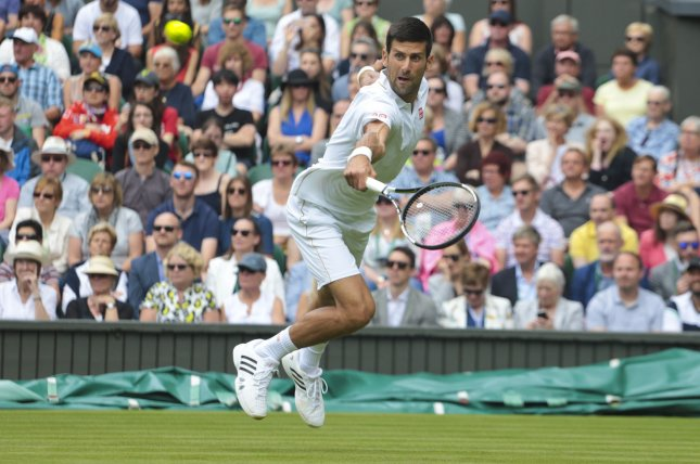 Serbian Novak Djokovic returns the ball in his match against Great Britain's James Ward on Day one of the 2016 Wimbledon Championships in Wimbledon, London June 27, 2016. Photo by Hugo Philpott/UPI