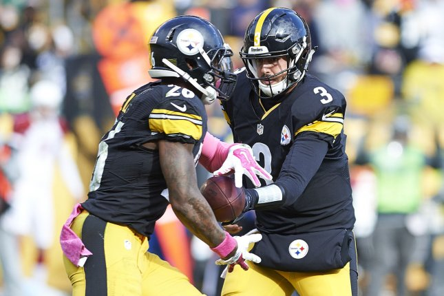 Pittsburgh Steelers quarterback Landry Jones (3) hands off to Pittsburgh Steelers running back Le'Veon Bell (26) in the third quarter at Heinz Field in Pittsburgh on October 18, 2015. Photo by Shelley LIpton/UPI