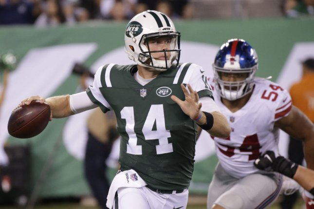 New York Jets quarterback Sam Darnold gets set to throw a pass in the 2nd quarter of a preseason game against the New York Giants on August 24 at MetLife Stadium in East Rutherford, N.J. Photo by John Angelillo/UPI