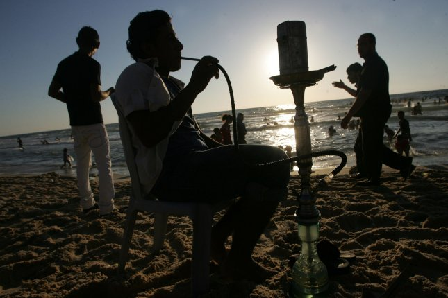 A person who smokes hookah for 30 minutes or longer will take in more toxic chemicals than smoking cigarettes for the same length. File Photo by Ismael Mohamad/UPI