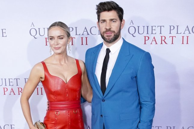 A Quiet Place Part II star Emily Blunt (L) and her husband, star and director John Krasinski arrive on the red carpet at the world premiere of the film in March 2020. Paramount has released a final trailer for the sequel. File Photo by John Angelillo/UPI