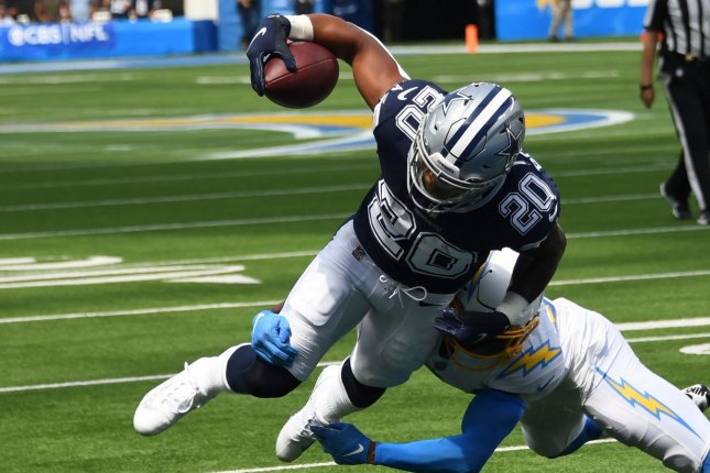 Dallas Cowboys running back Tony Pollard dives into the end zone against the Los Angeles Chargers on Sunday at SoFi Stadium in Inglewood, Calif. Photo by Jon SooHoo/UPI