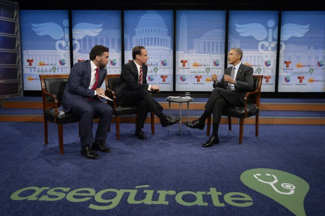 US President Barack Obama (R) participates in a town hall event on affordable health insurance, with moderator Jose Diaz Balart (C) and television host Enrique Acevedo (L), at the Newseum in Washington DC, March 6, 2014. Obama discussed how the Affordable Care Act, also known as 'Obamacare', affects Latinos. UPI/Michael Reynolds/Pool