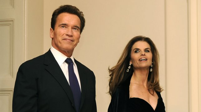 California Republican Gov. Arnold Schwarzenegger and former wife Maria Shriver arrive for a black-tie dinner at the White House, February 22, 2009. (FILE/UPI Photo/Mike Theiler)