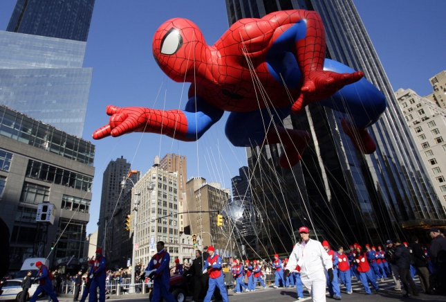A Spiderman balloon floats above marchers in New York City during Macy's Thanksgiving Parade Nov. 22, 2012. UPI/John Angelillo/File