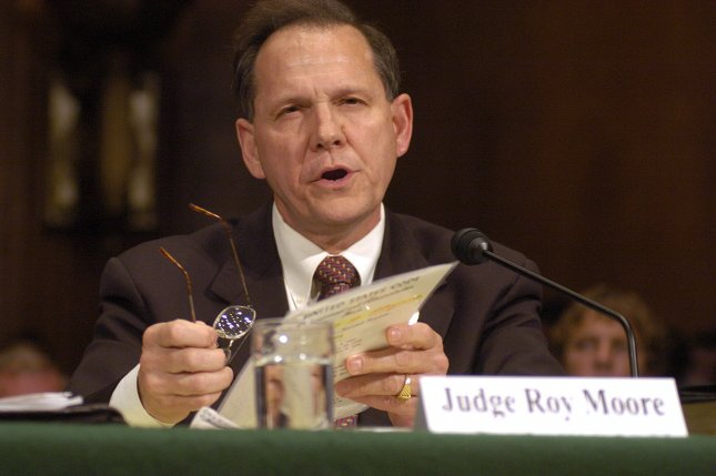 Roy Moore was suspended from the Alabama Supreme Court and charged with ethics violations for his efforts to block gay marriage in the state. The Chief Justice, pictured here after his first suspension in 2004 testifying before the Senate Judiciary Committee on the U.S. Constitution and Public Religious Expression in Washington, D.C., may lose his position for the second time. File Photo by Greg Whitesell/UPI