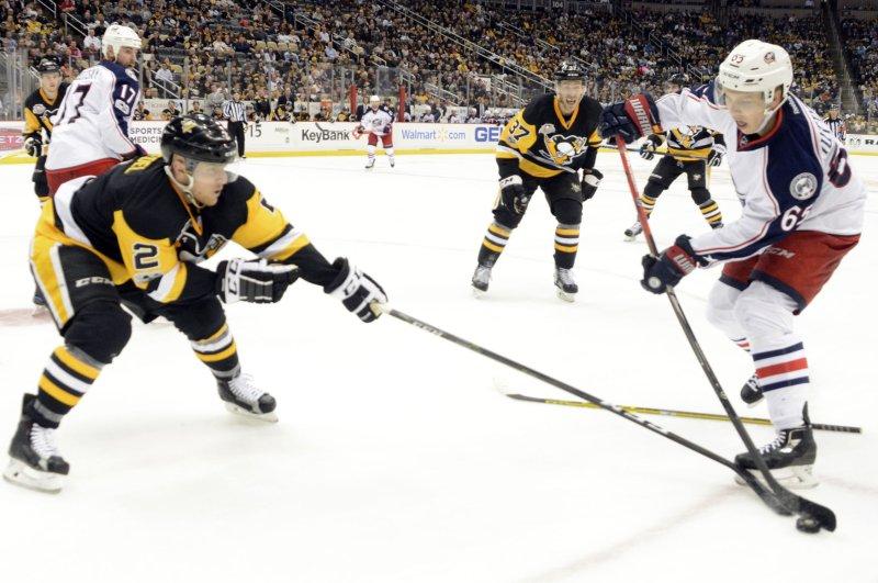 Pittsburgh Penguins defenseman Chad Ruhwedel tries to get past Columbus Blue Jackets defenseman Markus Nutivaara. Photo by Archie Carpenter/UPI