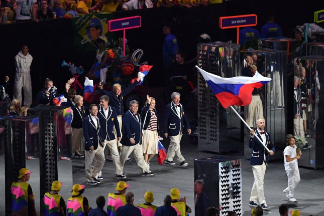Sergey Tetyukhin holds the flag of Russia as athletes enter the stadium at the opening ceremony of the 2016 Summer Olympic Games in Rio de Janeiro, Brazil. File Photo by Kevin Dietsch/UPI