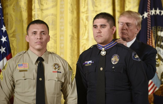 President Donald Trump presented the Public Safety Medal of Valor Award to 12 first responders including Officer Nicholas Koahou, Redlands Police Department and five others who responded to the 2015 San Bernadino massacre. Photo by Leigh Vogel/UPI