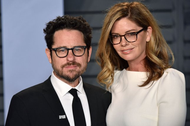 Filmmaker J.J. Abrams (L) and his wife Katie McGrath. Abrams posted on Twitter an on-set photo from Star Wars: Episode IX which appears to feature star John Boyega. File Photo by Christine Chew/UPI