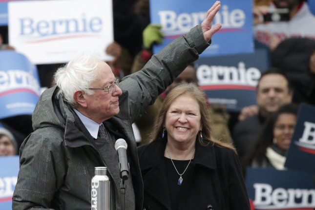 Sen. Bernie Sanders waves to supporters while standing next to wife Jane O'Meara Sanders after he speaks at his first event of his 2020 presidential campaign at Brooklyn College in New York City on March 2. Photo by John Angelillo/UPI