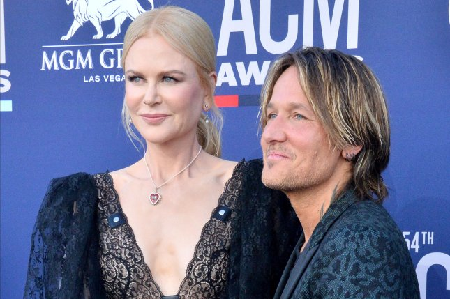 Nicole Kidman (L), pictured with Keith Urban, discussed motherhood and how she's raising daughters Sunday and Faith to be religious. File Photo by Jim Ruymen/UPI
