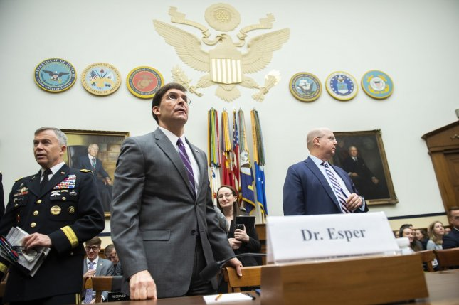 Defense Secretary Mark Esper arrives to testify on the Defense Department's fiscal 2021 budget request Wednesday. Photo by Kevin Dietsch/UPI