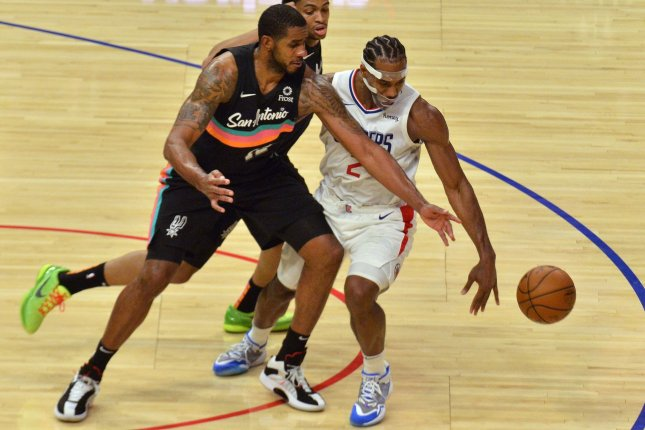 San Antonio Spurs' LaMarcus Aldridge (L), who announced his retirement Thursday, tries to wrest control of the ball from the Los Angeles Clippers' Kawhi Leonard during second-half action January 5 at Staples Center in Los Angeles. File Photo by Jim Ruymen/UPI