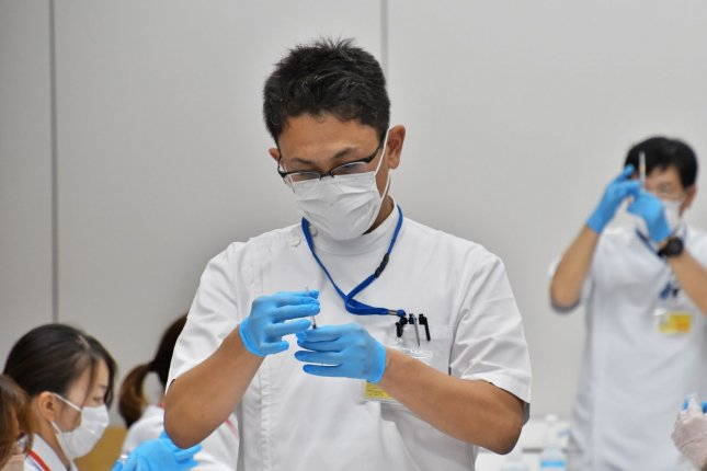 A medical worker fills a syringe with a dose of the Moderna vaccine at the Japan Self-Defense Forces' large-scale COVID-19 vaccination centers in Osaka, Japan, on June 25. File Photo by Keizo Mori/UPI