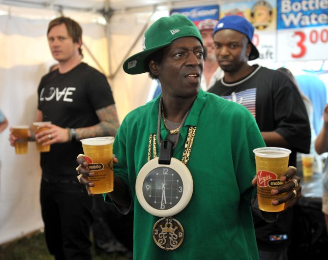 Flava Flav serves beer at a vendor tent at the Virgin Mobil Freefest at the Merriweather Post Pavilion in Columbia, Maryland on August 30, 2009. UPI/Kevin Dietsch