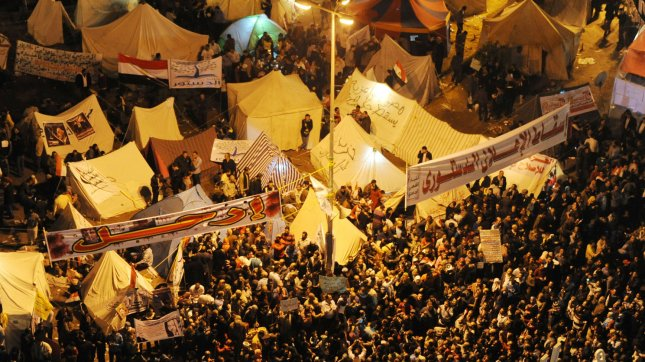 Egyptian protesters stand next to makeshift tents and shout slogans against the President Mohamed Morsi, in Tahrir Square, Cairo, Egypt, on November 27, 2012. UPI/Mohammad KHalil