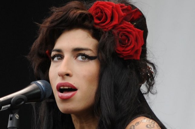 British singer Amy Winehouse was found dead in her home on July 23, 2011 in London. She was 27. She is shown performing at V Festival in Hylands Park in Chelmsford on August 17, 2008. UPI/Rune Hellstad/Files