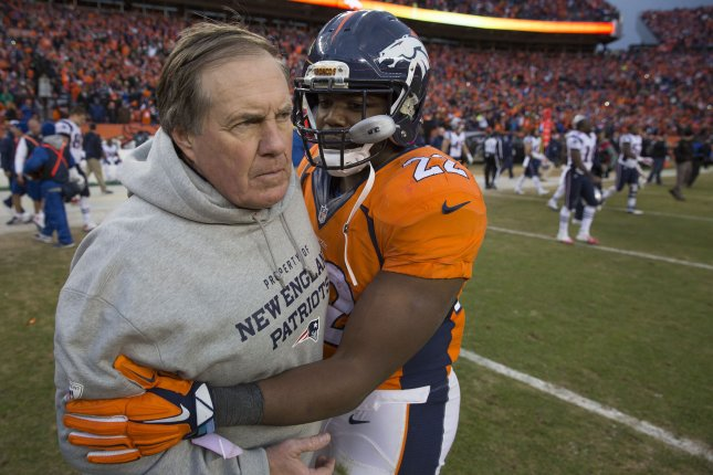 Denver Broncos running back C.J. Anderson hugs New England Patriots head coach Bill Bilichick after the AFC Championship game at Sport Authority Field at Mile High in Denver on January 24, 2016. Denver advances to Super Bowl 50 defeating New England 20-18. Photo by Gary C. Caskey/UPI