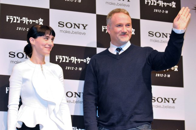 Actress Rooney Mara (L) and director David Fincher attend the press conference for the film The Girl With the Dragon Tattoo in Tokyo in 2012. Director Fede Alvarez is in talks to helm the sequel titled, The Girl in the Spider Web. File Photo by Keizo Mori/UPI
