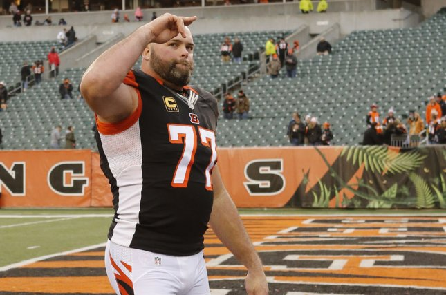 Cincinnati Bengals offensive lineman Andrew Whitworth (77) signals to Bengals fans as he walks off the field. File photo by John Sommers II/UPI