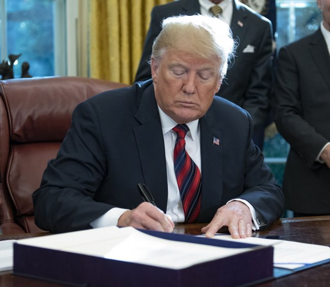 United States President Donald Trump singed America's Water Infrastructure Act of 2018 in the Oval Office of the White House on Tuesday, authorizing new water infrastructure programs throughout the United States. Photo by Ron Sachs/UPI