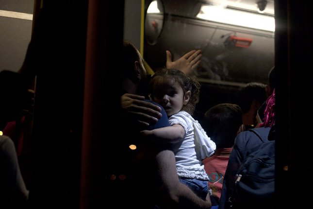 Migrants disembark from a passenger ship on the Aegean coast in 2015. The sea is a popular route for migrants fleeing the Middle East for Europe. File Photo by Yuksel Pecenek/UPI