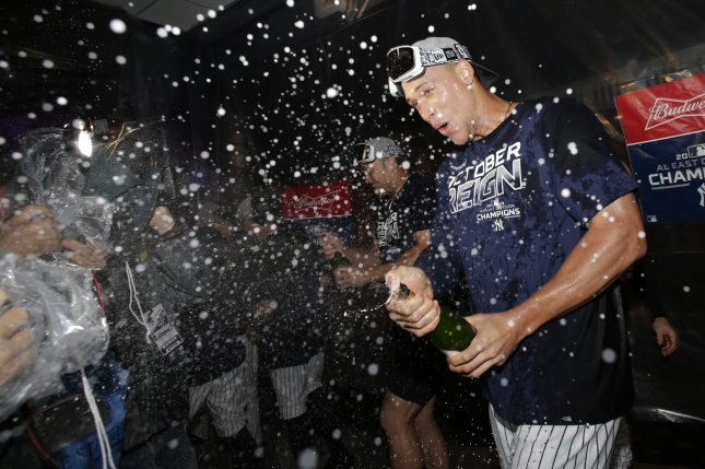 New York Yankees outfielder Aaron Judge celebrates in the club house with champagne after the Yankees defeated the Los Angeles Angels to win the American League East title on Sept. 19, 2019, at Yankee Stadium. The Yankees advanced to the ALCS in the MLB postseason. Photo by John Angelillo/UPI