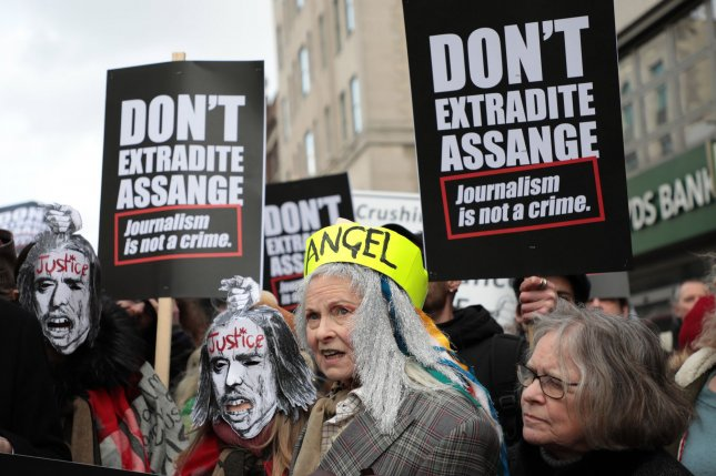Fashion designer Vivienne Westwood poses Saturday with a group of activists fighting to stop the extradition of Julian Assange to the United States, in London, Britain. Photo by Hugo Philpott/UPI