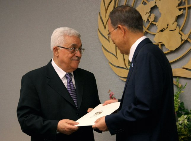 Mahmoud Abbas (L), Palestinian Authority president, presents Secretary-General Ban Ki-moon with a letter requesting Palastinian statehood at the United Nation on September 23, 2011 in New York City. Abbas is asking the UN to recognize Palestinian statehood, against the wishes of the US and Israel. UPI/Monika Graff