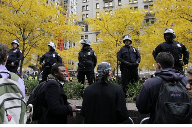 Protesters have returned to Zuccotti Park after the NYPD has removed its barricades from the area. UPI/John Angelillo