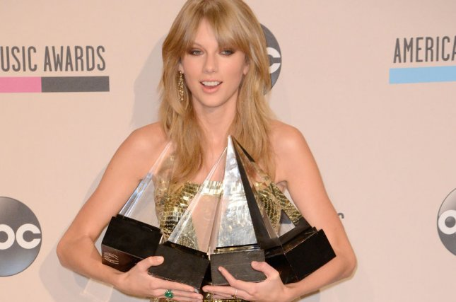 Recording artist Taylor Swift, winner of Artist of the Year, Favorite Female Artist - Country, and Favorite Album - Country for 'Red, backstage at the 41st annual American Music Awards held at Nokia Theatre L.A. Live in Los Angeles on November 24, 2013. UPI/Phil McCarten